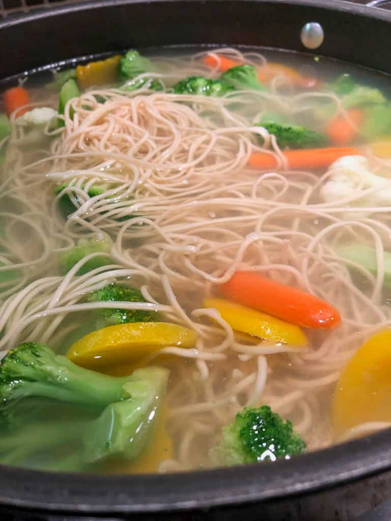Asian Noodles and vegetables boiling