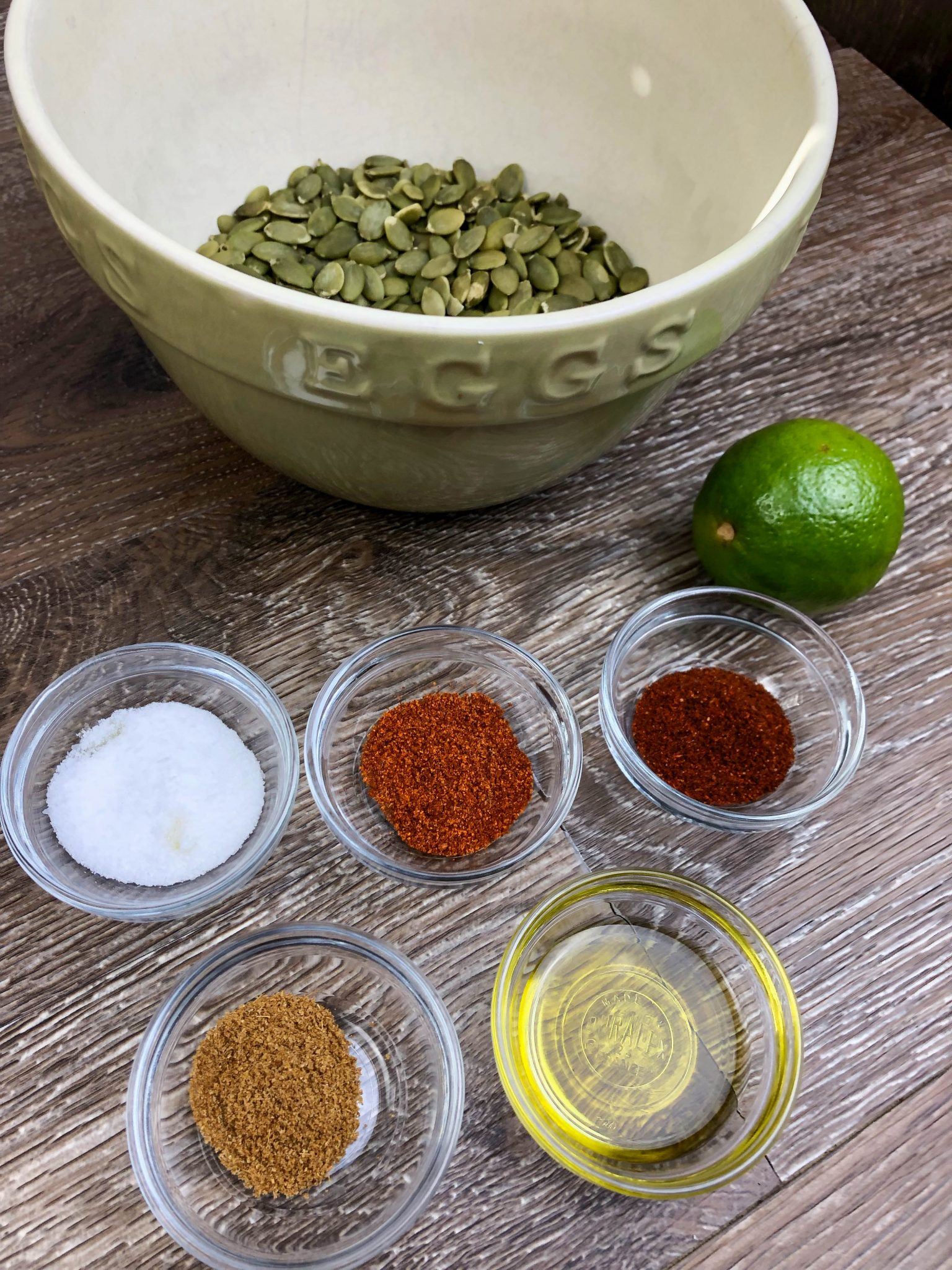 Pumpkin Seeds, Olive Oil, Cayenne, Cumin, Chili Powder, Salt