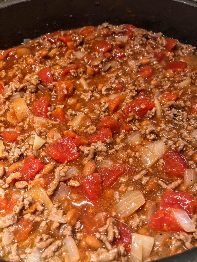 beef mixture simmering in skillet