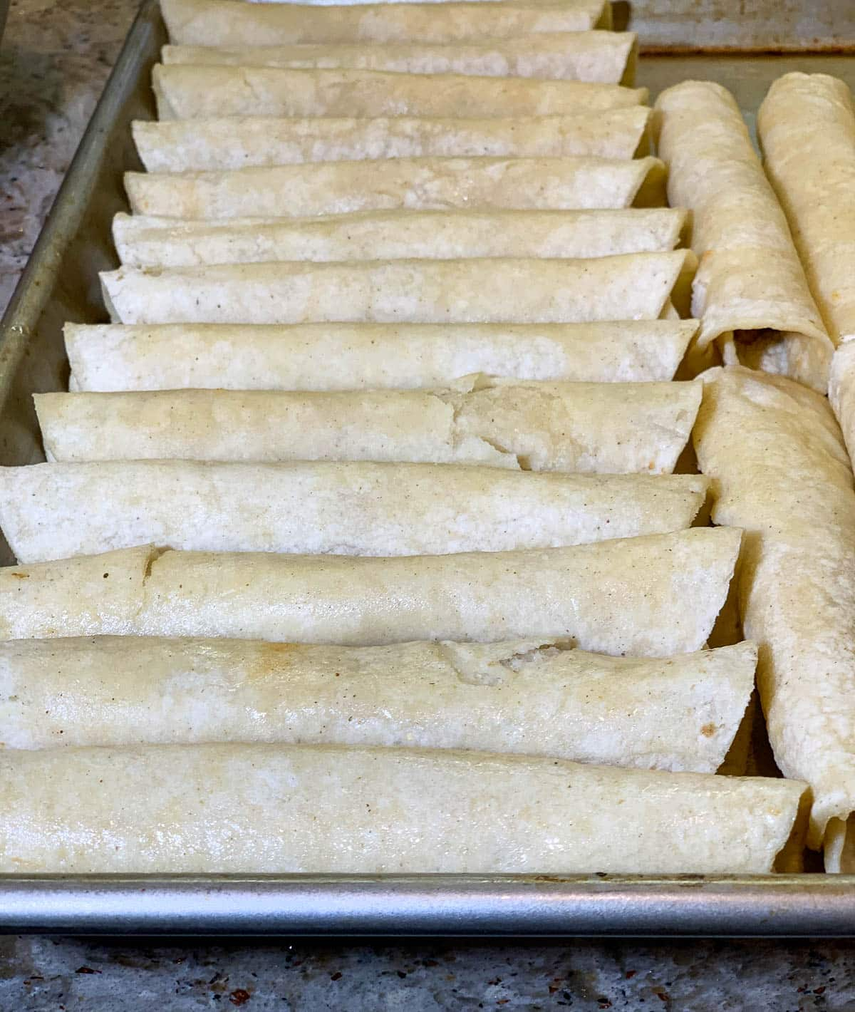 corn burritos on baking sheet