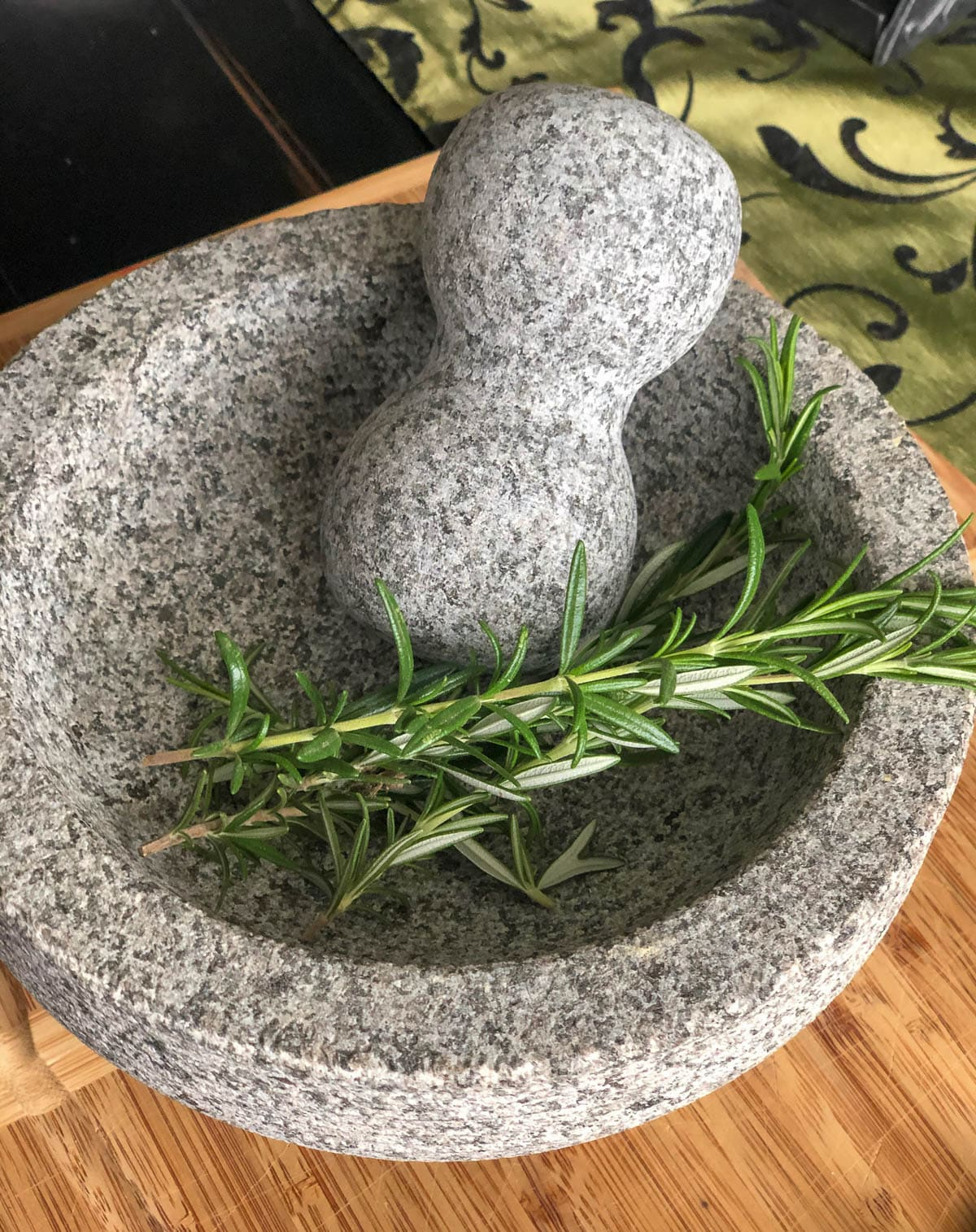 fresh rosemary in mortar and pestle