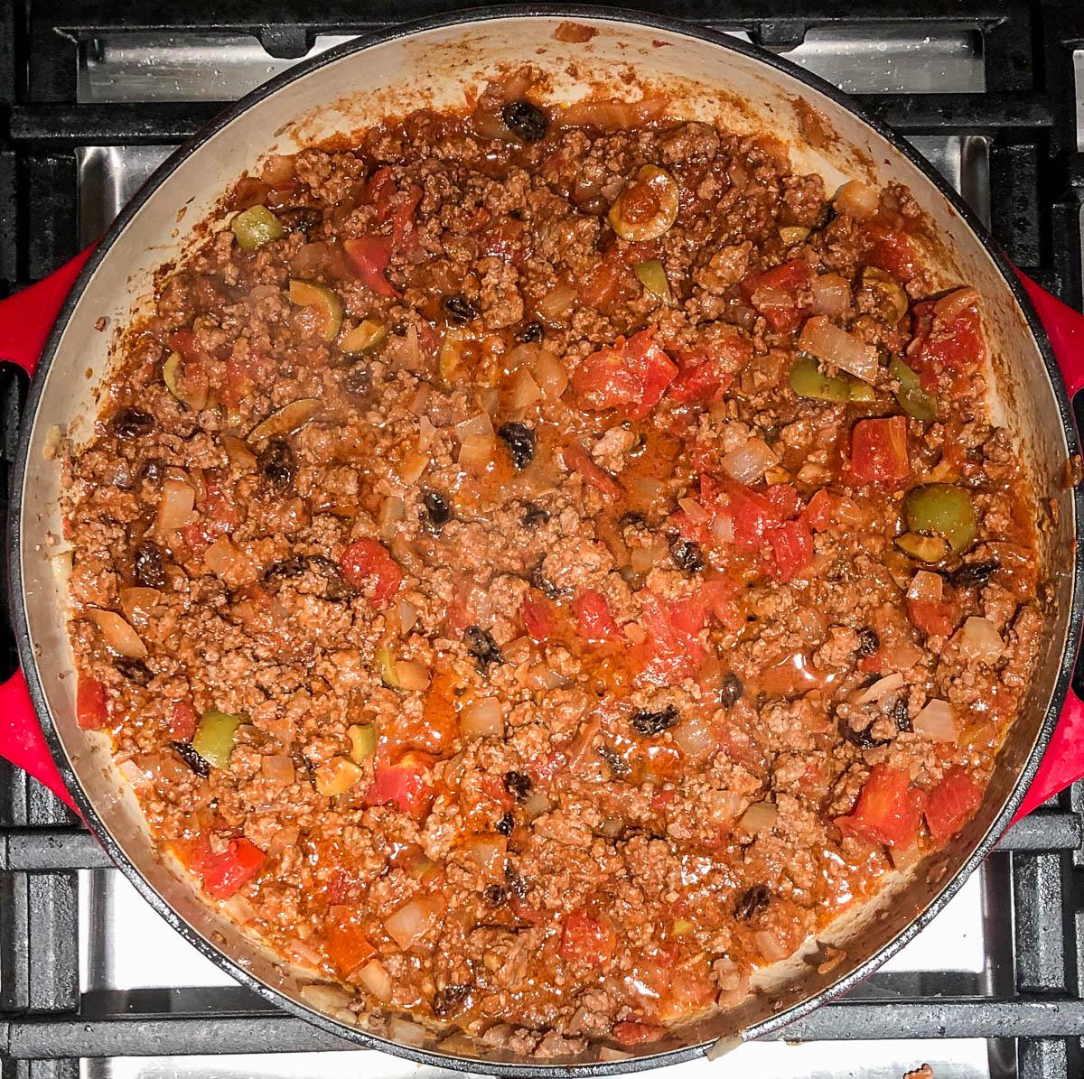 easy beef picadillo simmering