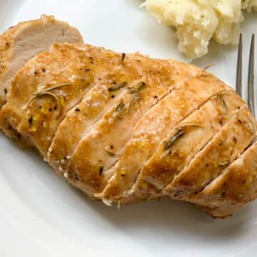 sliced chicken breast with fork