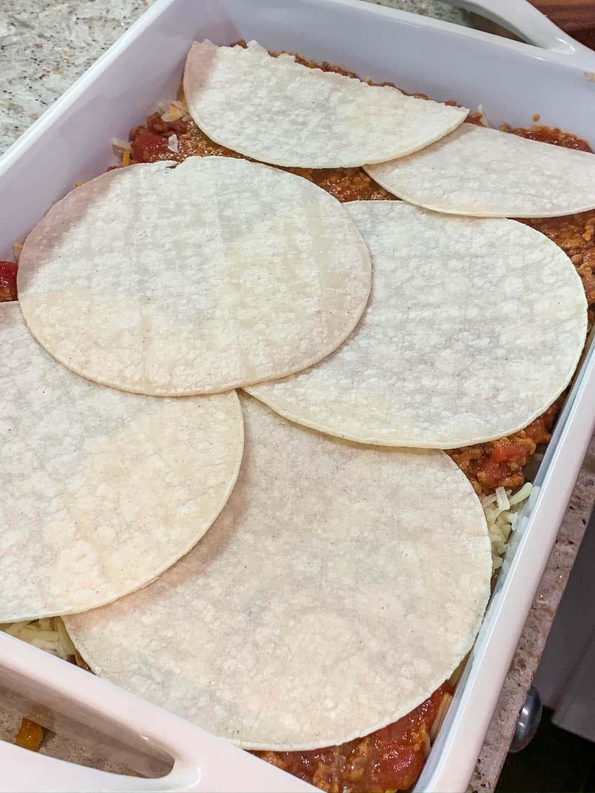 corn tortillas on meat mixture