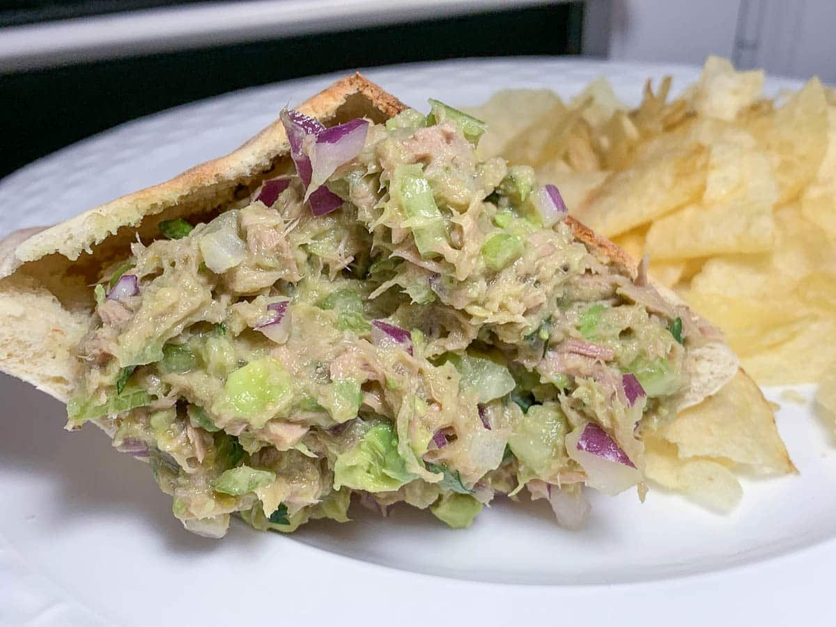 sandwich on a plate with potato chips
