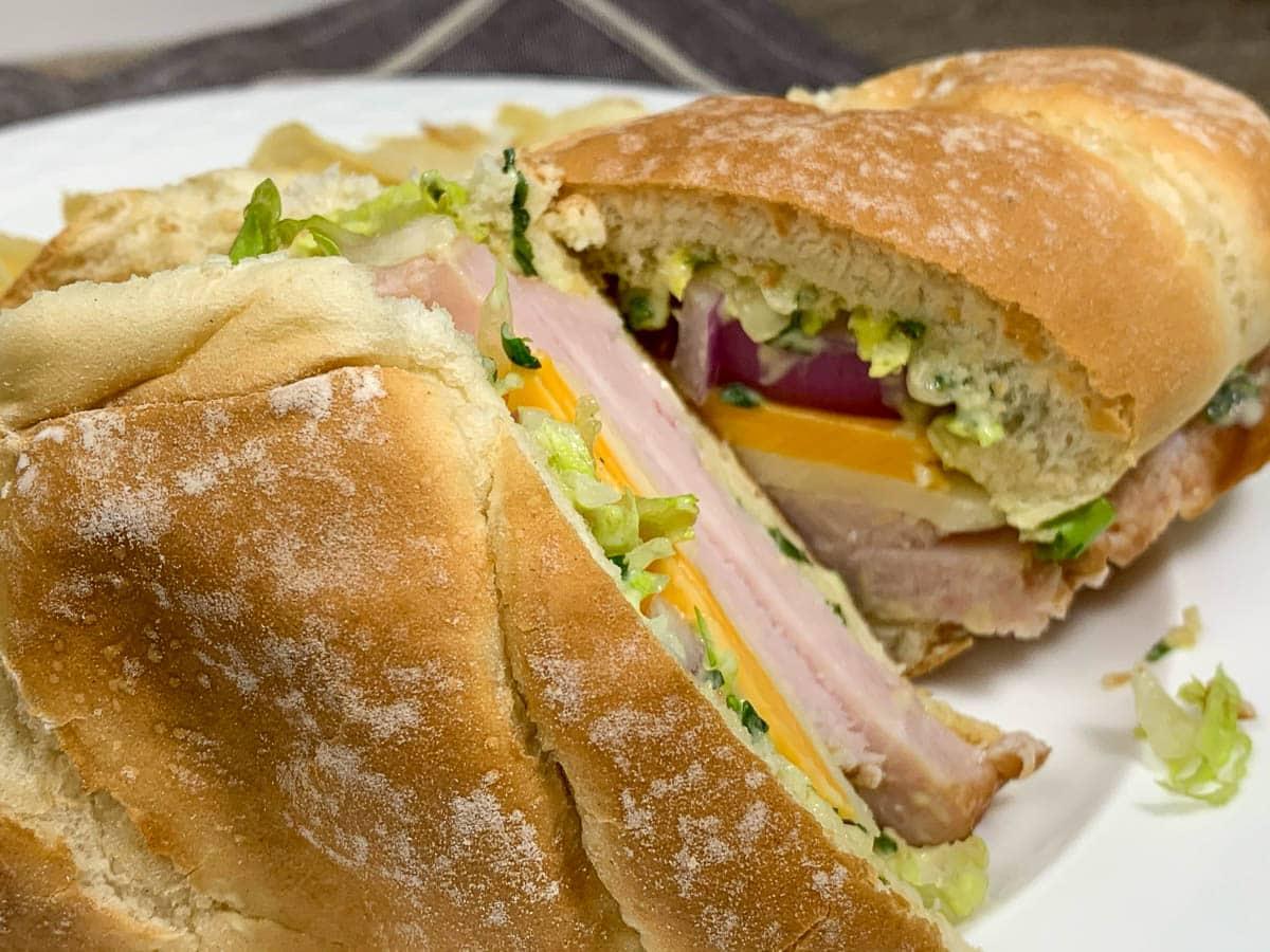 club house sandwich on white plate