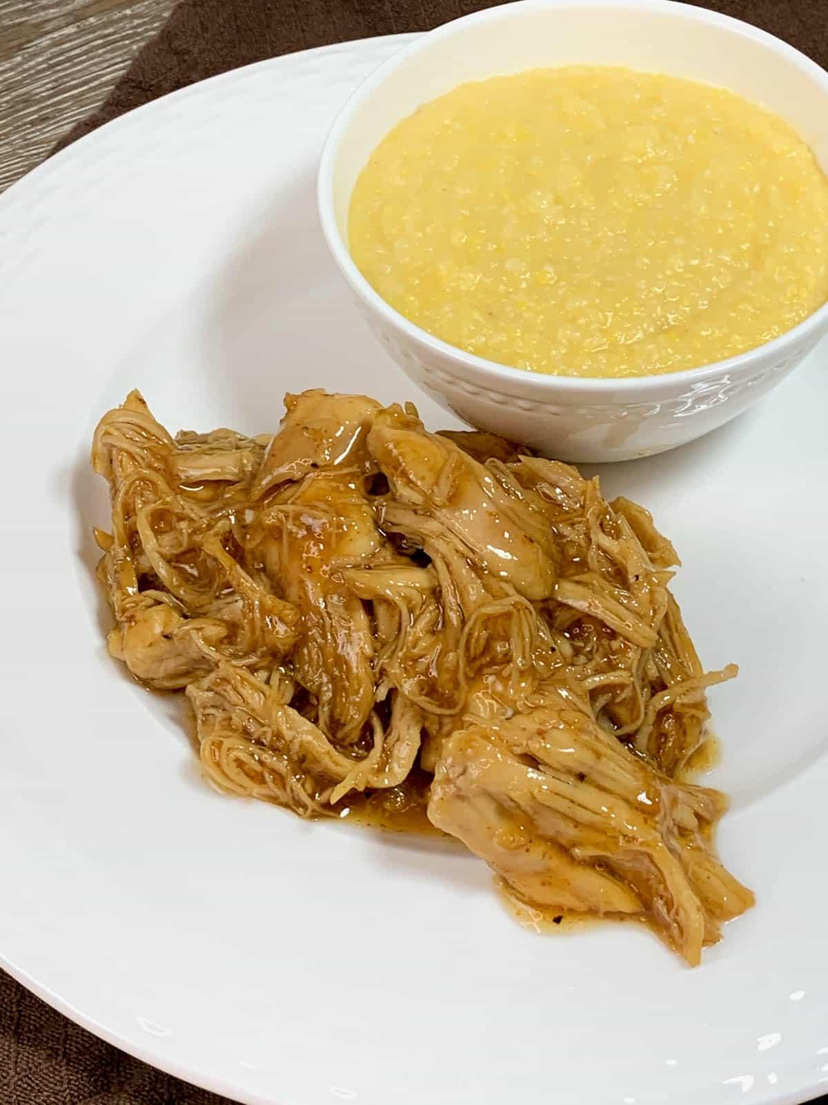 brown sugar chicken with bowl of parmesan polenta
