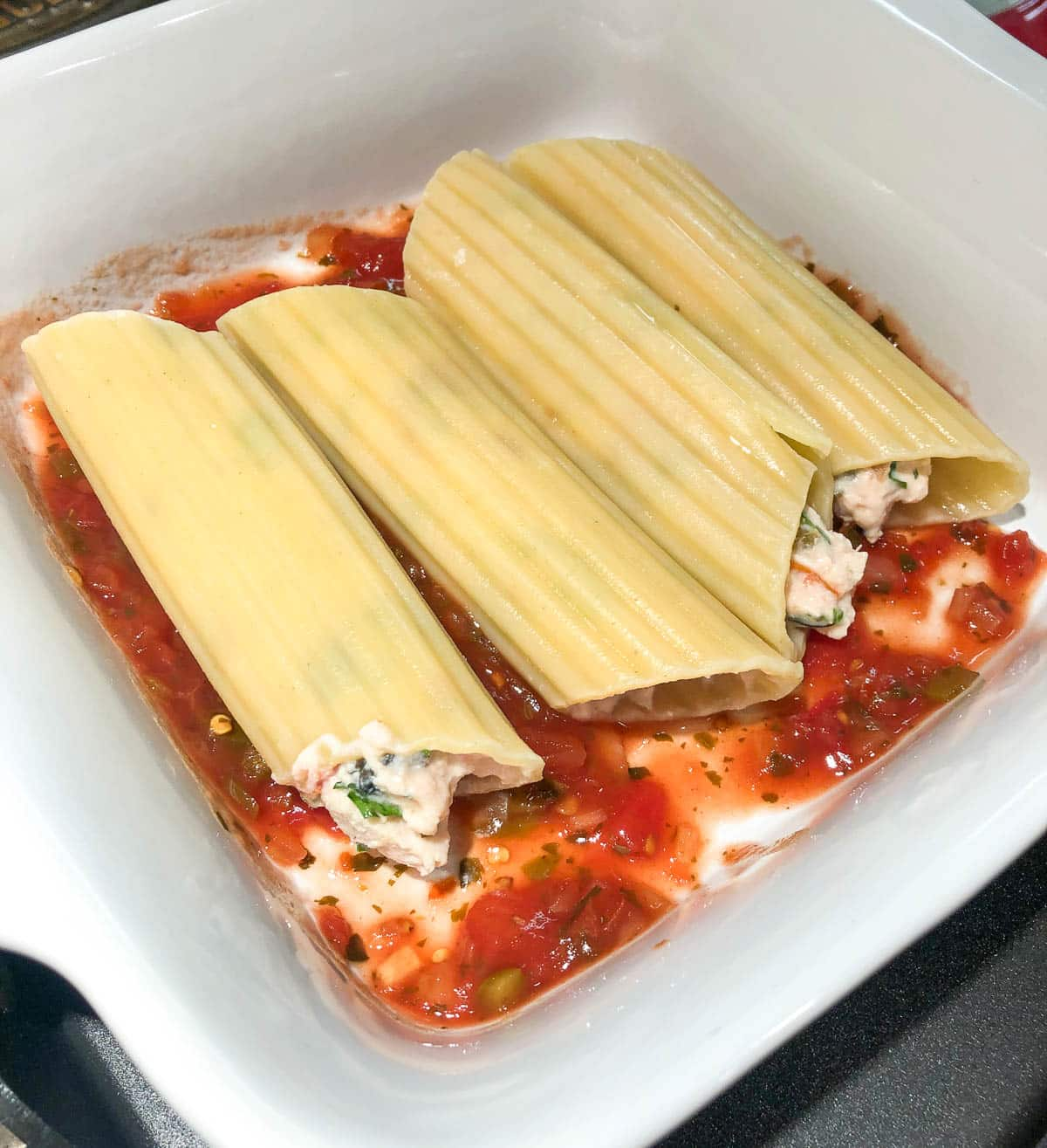 stuffed manicotti shells ready for the oven