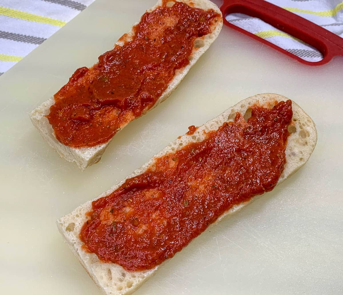 pizza sauce on french baguette