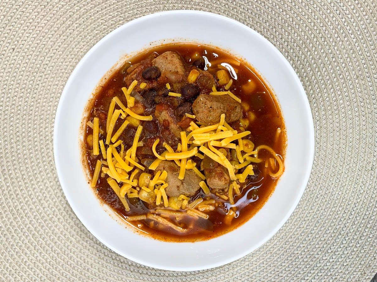 pork chili in a white bowl