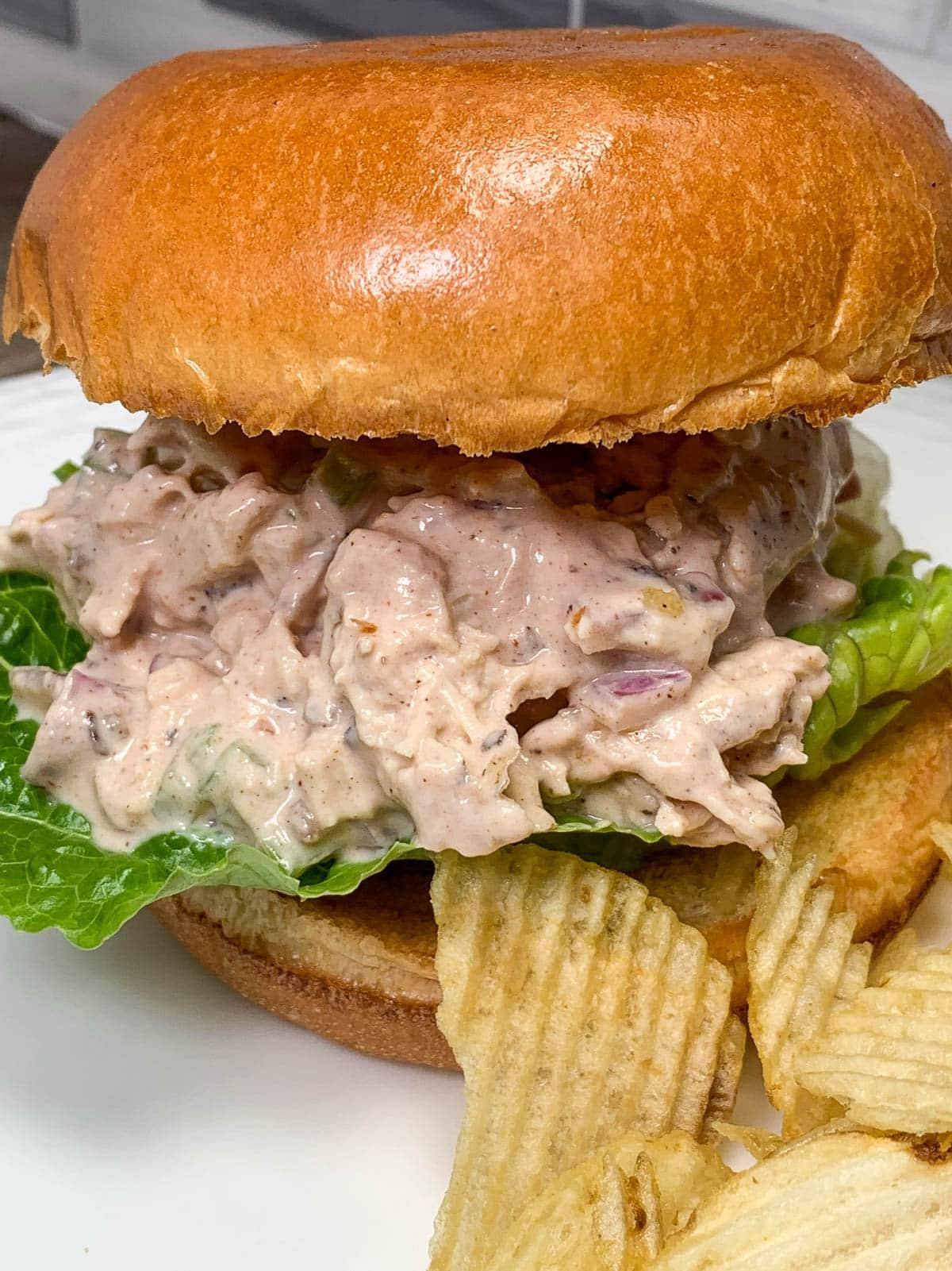 chicken salad sandwich with potato chips
