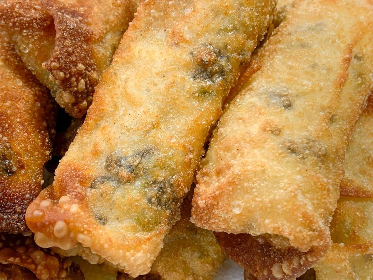 closeup of deep fried egg rolls