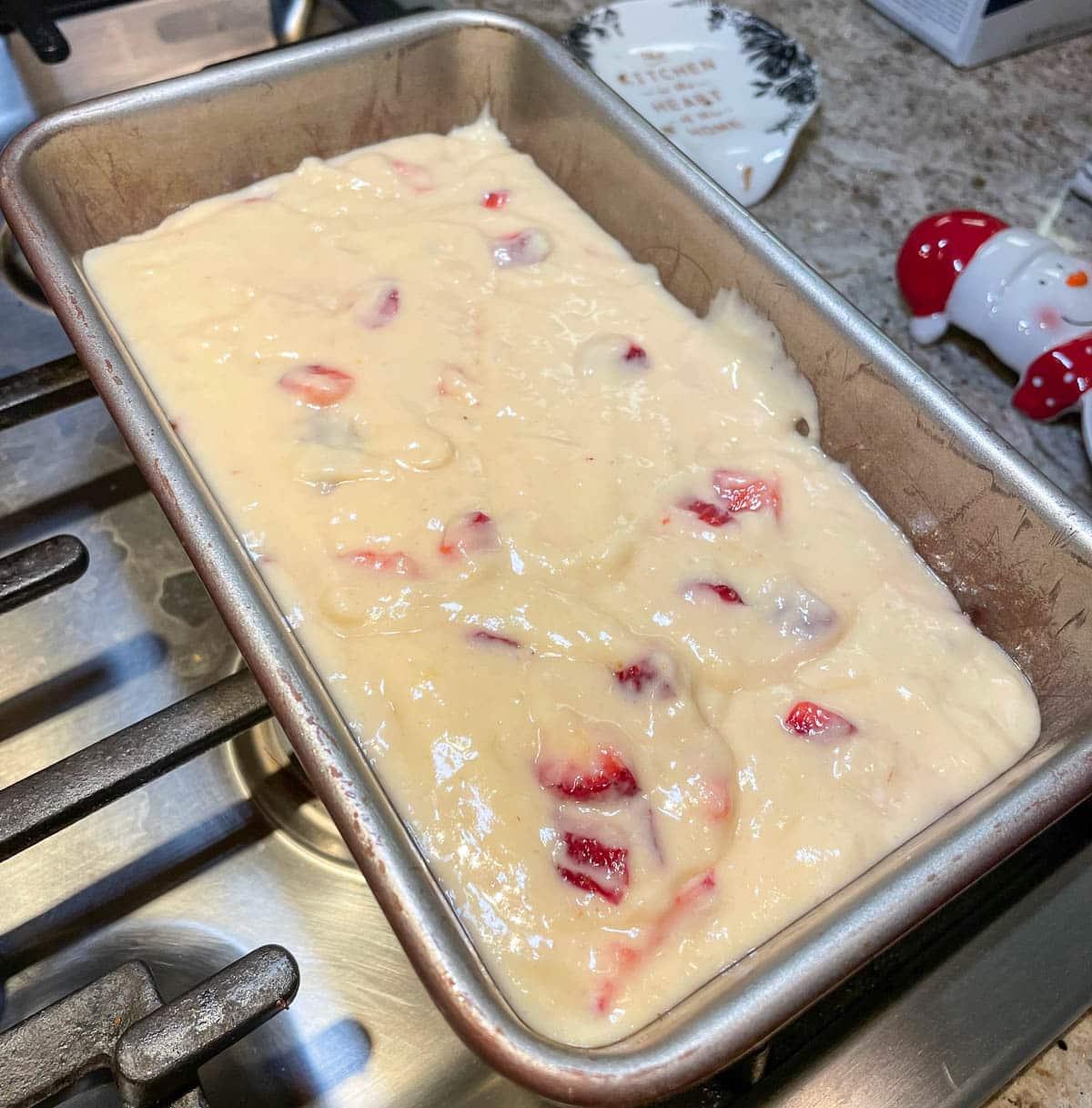 pound cake batter in loaf pan
