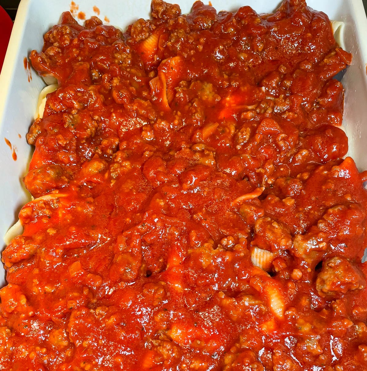 stuffed shells covered in meat sauce
