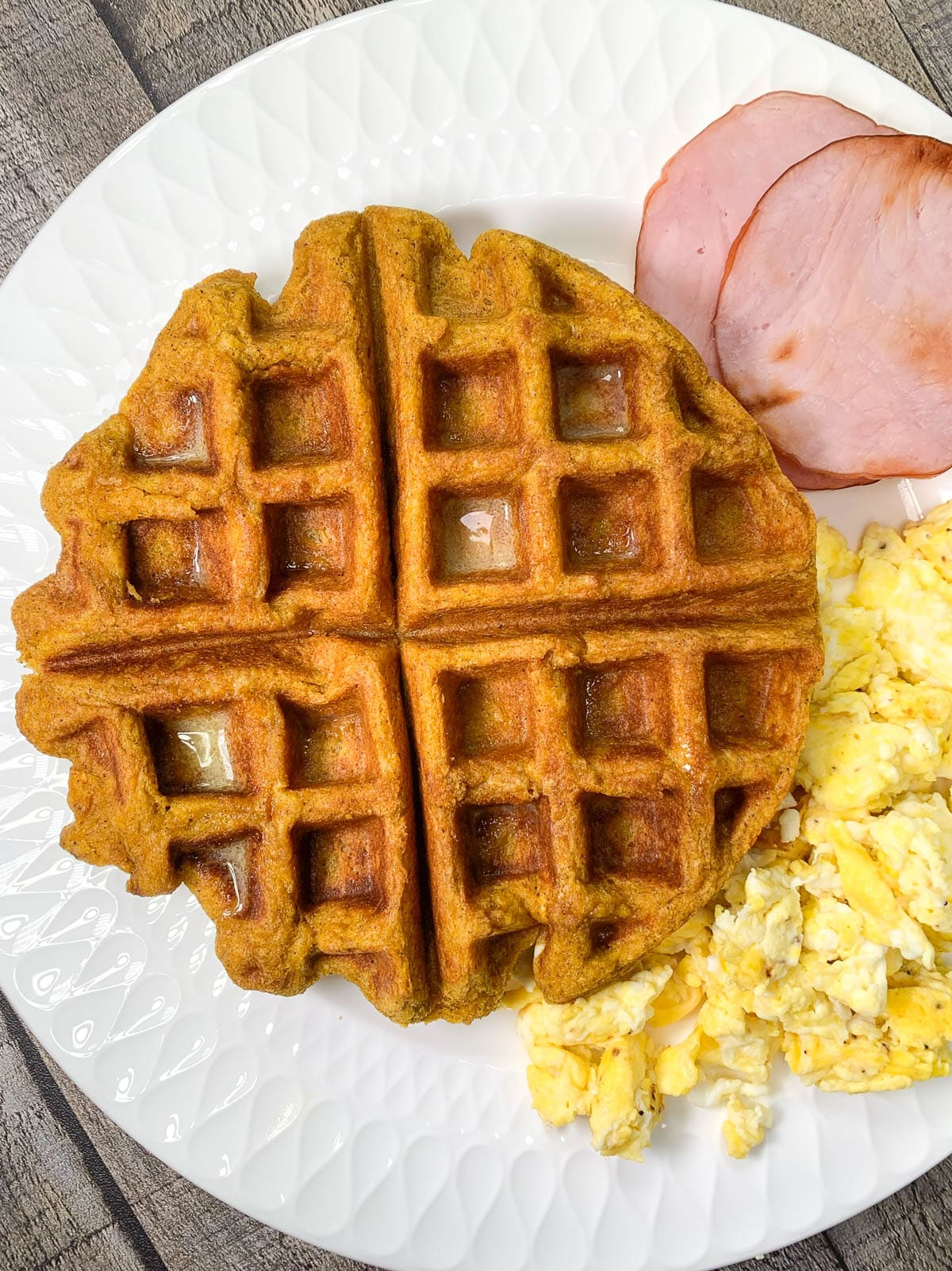 pumpkin waffles with eggs and ham
